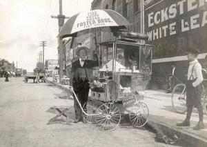 George C Day Sr with his popcorn cart downtown Port Huron. Eddie Smith Looking On.